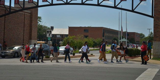 WELLSTON, MO - AUGUST 21: Students leave Normandy High School    at the end of the school day as the drama of the killing of