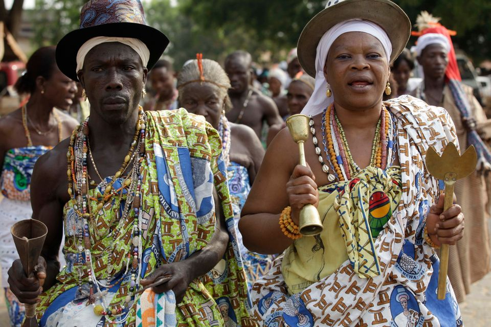 Voodoo worshippers dance at the Temple of Pythons during the annual Voodoo Festival in Ouidah, Benin.  (AP Photo/Sunday Alamb