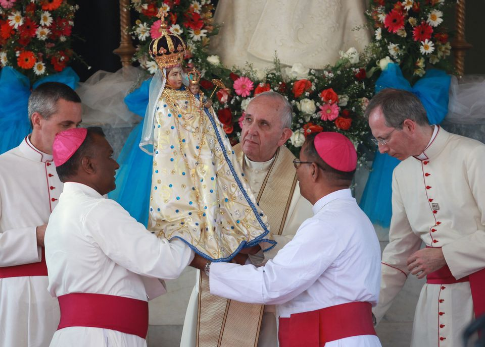 Pope Francis holds a statute of Our Lady of Madhu during his visit to the church in Madhu, Sri Lanka, on January 14, 2015.