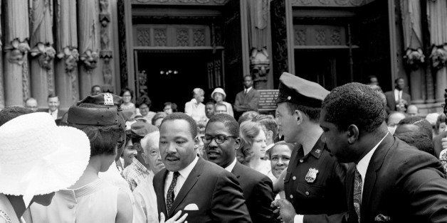 UNITED STATES - AUGUST 08:  Dr. Martin Luther King Jr. speaks to the press outside of Riverside Chruch after preaching the mo