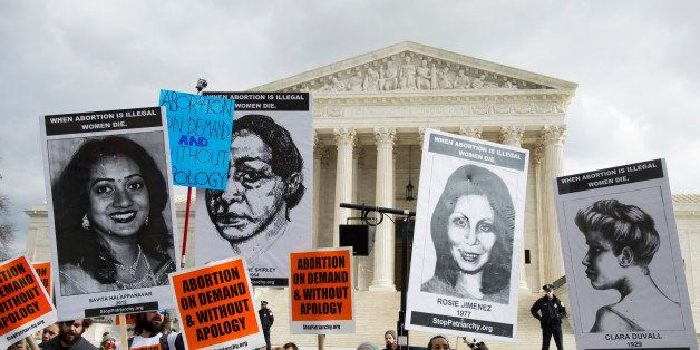UNITED STATES - JANUARY 22: Pro-choice protesters chant in front of the Supreme Court on Thursday, Jan. 22, 2015, the anniver