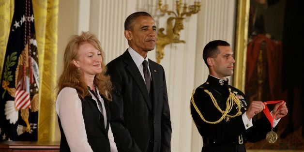 President Barack Obama awards the 2013 National National Humanities Medal to Krista Tippett, radio host, from St. Paul, Minn.