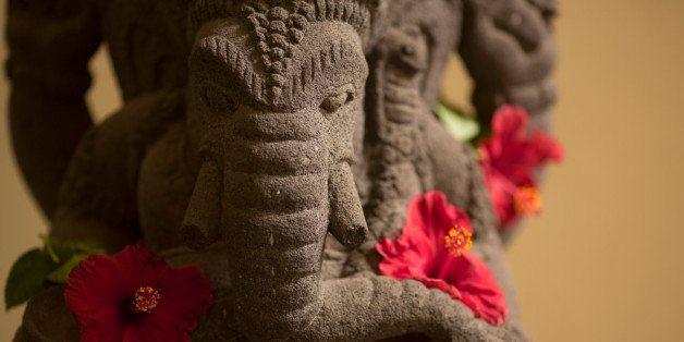 JAKARTA, INDONESIA - NOVEMBER 02: Statue of the Hindu divinity Ganesha, also known as Ganapati and Vinayaka, with hibiscus fl