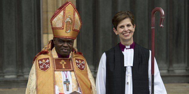 Bishop Libby Lane (R) poses for pictures with Archbishop of York, Dr John Sentamu, as they leave York Minster in northern Eng