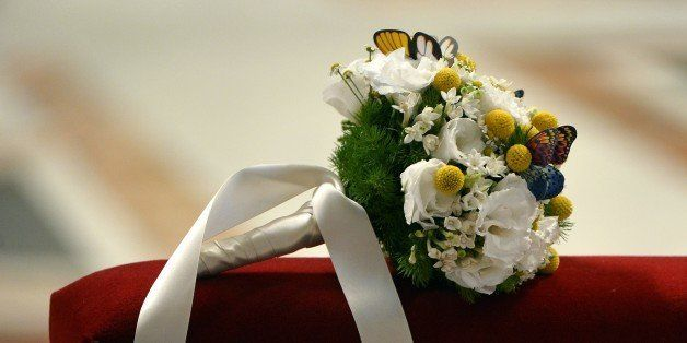 A bridal bouquet lays on a bench during a wedding ceremony celebrated as part of a mass by Pope Francis at St Peter's basilic