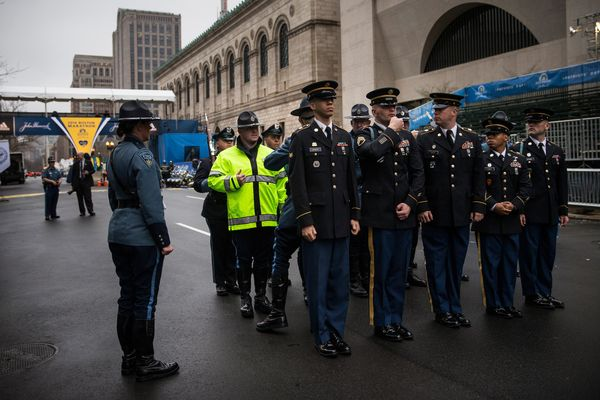 Members of the Boston Police Department, Boston Fire Department and Massachusetts State Police practice ahead of ceremony.