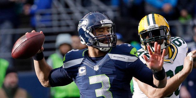 Seattle Seahawks quarterback Russell Wilson drops back to pass during the first half of the NFL football NFC Championship gam