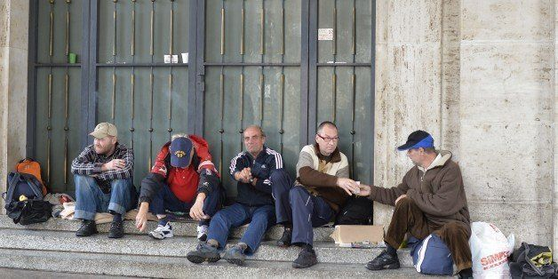 Homeless men chat at the Vatican on November 17, 2014. Pope Francis has ordered the installation of showers for the homeless