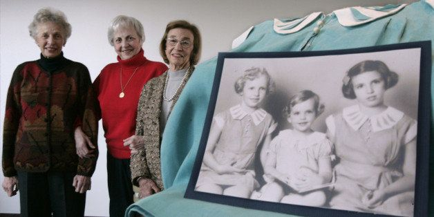 Three Sisters, from the left, Peggy Selonick, Susan Stern, and Jane Ellis, pose near a photo showing themselves in the same o