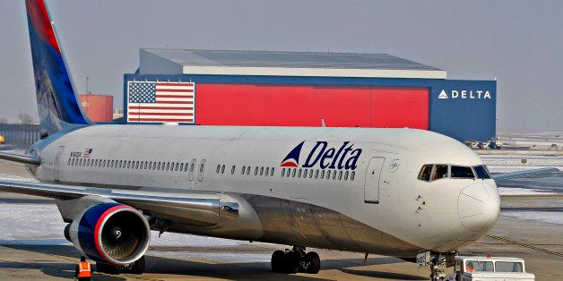 A Delta Air Lines Inc. Boeing 767-332  (N1402A) is pushed back from a gate at the Salt Lake City International Airport in Sal