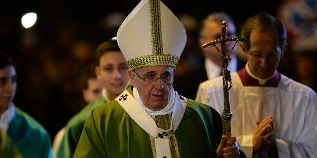 Pope Francis arrives to lead a mass during a pastoral visit at the parish of San Michele Arcangelo a Pietralata, on February