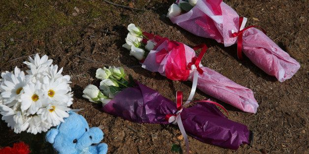RALEIGH, NC - FEBRUARY 12:   Three sets of flowers commemorate three students recently murdered in Chapel Hill, N.C., before