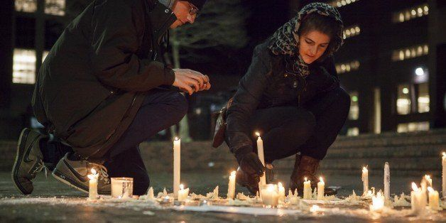 CHAPEL HILL, USA - FEBRUARY 11: Lee Elliott (L) from Chapel Hill, N.C. and Tera Schmitt (R) from Durham, N.C. relight candles