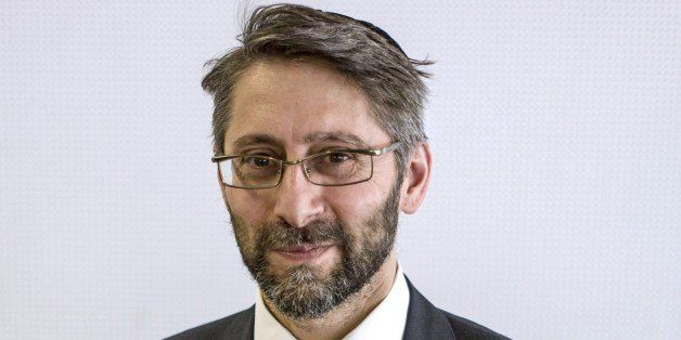 The newly elected 'Great Rabbi of France' Haim Korsia, poses for a photograph on June 22, 2014, in Paris. Korsia, 51, was ele