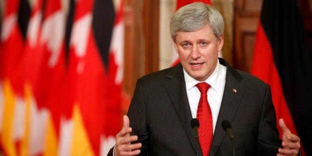 OTTAWA, CANADA -FEBRUARY 09:  Canada's Prime Minister Stephen Harper addresses media alongside German Chancellor Angela Merke