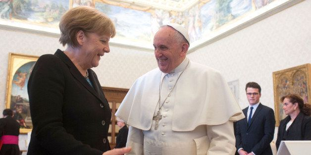VATICAN CITY, VATICAN - FEBRUARY 21:  Pope Francis exchanges gifts with Chancellor of Germany Angela Merkel during a private