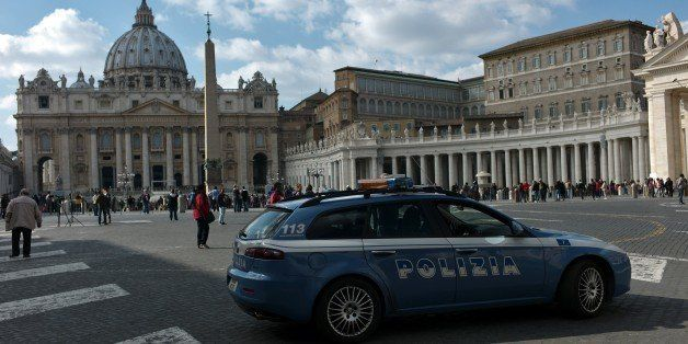 Policemen patrol at St Peter's square on February 19, 2015 at the Vatican. Security at the Vatican and across Italy has been