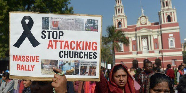 Minority Indian Christians demonstrate outside the Sacred Heart Cathedral following recent attacks on churches in New Delhi o