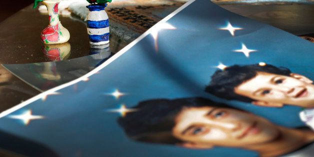 FILE -In this  Dec. 10, 2014 file photo, Prison artwork created by Adnan Syed sits near family photos in the home of his moth