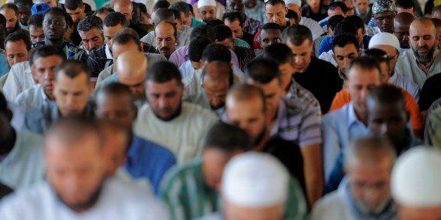 Muslims offer prayers on the last Friday of Ramadan in Lleida, Spain, Friday, Sept. 10, 2010. (AP Photo/Manu Fernandez)