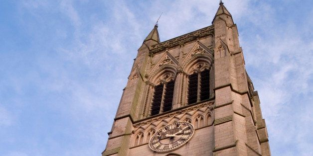'The church tower and clock at Bolton parish church, Lancashire.'
