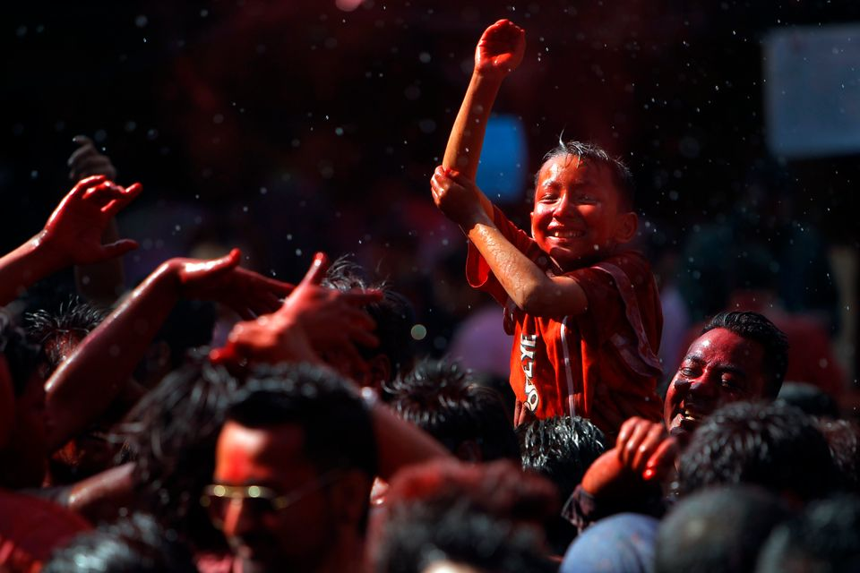 A Nepalese boy dances during celebrations marking Holi, the Hindu festival of colors, in Kathmandu, Nepal, Thursday, March 5,