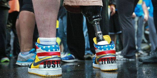 BOSTON - APRIL 15: Boston Marathon bombing victim J.P. Norden wore colorful sneakers with 'Boston Strong' written on the back