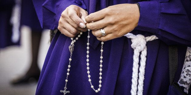 ROME, ITALY - 2014/10/05: Peruvian woman, known as 'Sahumadoras', holds a rosary while participating in a procession in Rome