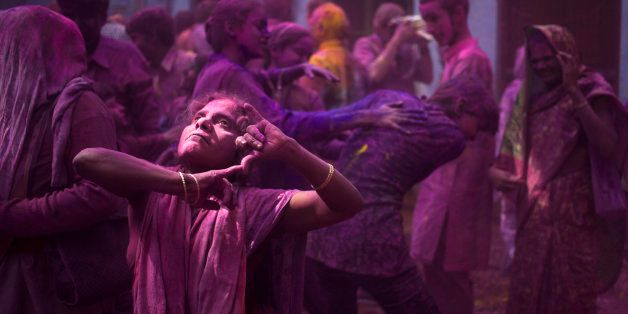 Indian Hindu widows and others play with colored powder as part of Holi celebrations at the  Meera Sahabhagini Widow Ashram i