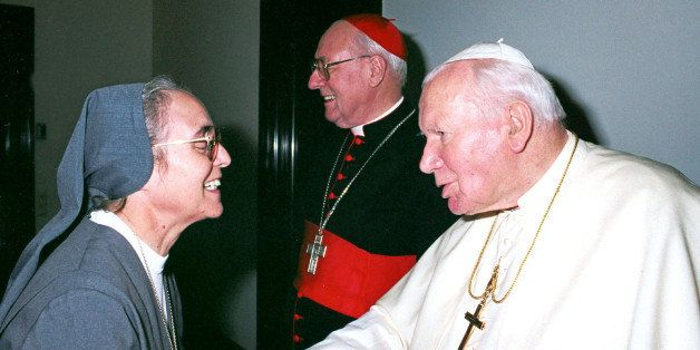 Pope John Paul II is greeted by Sister Enrica Rosanna, of the Salesian order, in this 2002 photo made available by the Vatica