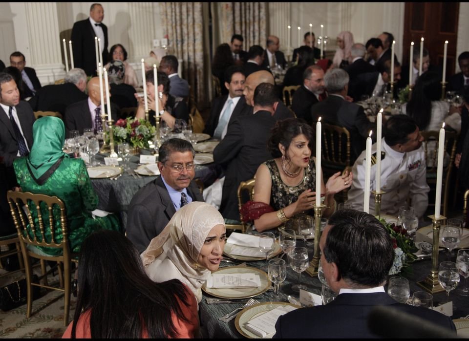 Guests gather at their tables as President Barack Obama hosts an iftar dinner, the meal that breaks the dawn-to-dusk fast for