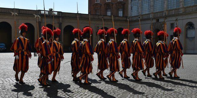 Swiss guards stand in the courtyard of the Vatican on March 9, 2015.  AFP PHOTO / GABRIEL BOUYS        (Photo credit should r