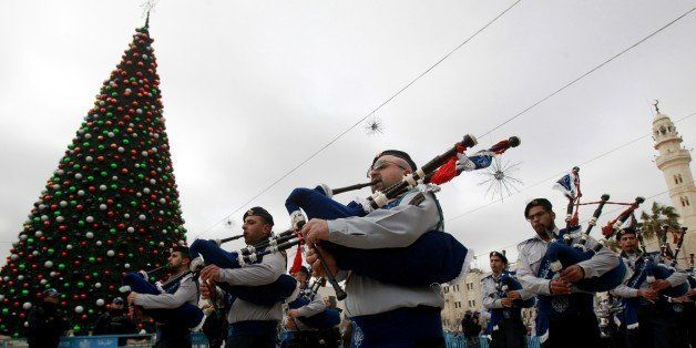 Palestinians play the bagpipes as they take part in celebrations for the Orthodox Christmas outside the Church of the Nativit