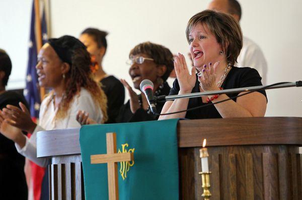 """<a href=""""https://www.huffpost.com/entry/ferguson-pastor-shot-police-rubber-bullet_n_5678973"""" target=""""_blank"""">Pastor Renita La"""