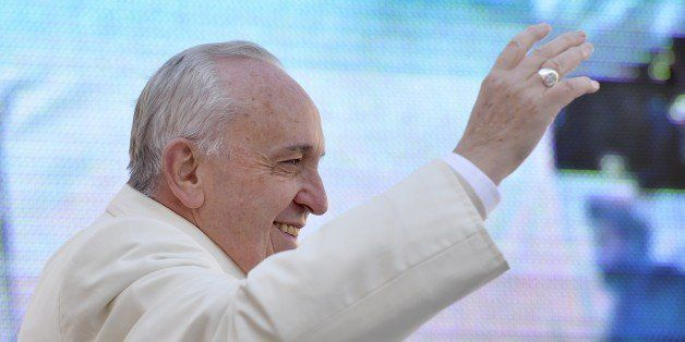 Pope Francis waves to the crowd as he arrives in St Peter's square for the 60th anniversary of the Comunione e Liberazione (C