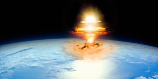 Planet earth with atomic blast