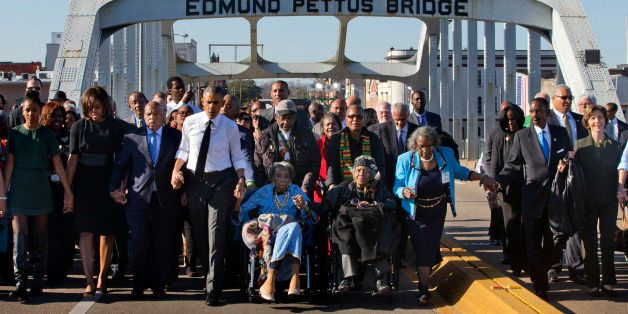 """President Barack Obama, fourth from left, walks holding hands with Amelia Boynton Robinson, who was beaten during """"Bloody Sun"""