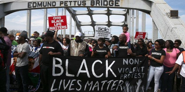 SELMA, AL - MARCH 08:  Thousands of people walk across the Edmund Pettus Bridge during the 50th anniversary commemoration of