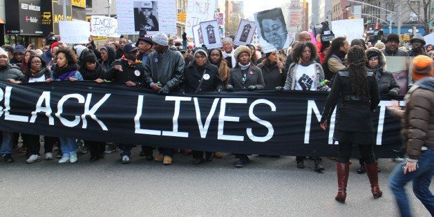 NEW YORK, NY - DECEMBER 13: Thousands of protestors converge on Manhattan's Washington Square Park to march through the Manha