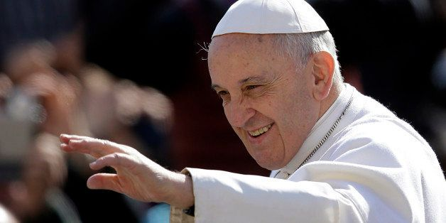 Pope Francis waves to faithful as he arrives for his weekly general audience in St. Peter's Square, at the Vatican, Wednesday