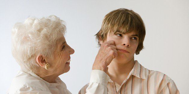 Woman grabbing grandson's cheek
