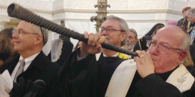 Rabbi Wayne Franklin of Temple Emanu-El in Providence, R.I., blows the Shofar, a Jewish tradition to call the community to as