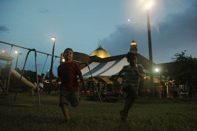 Kids running outside the Islamic Center of Northeast Florida.