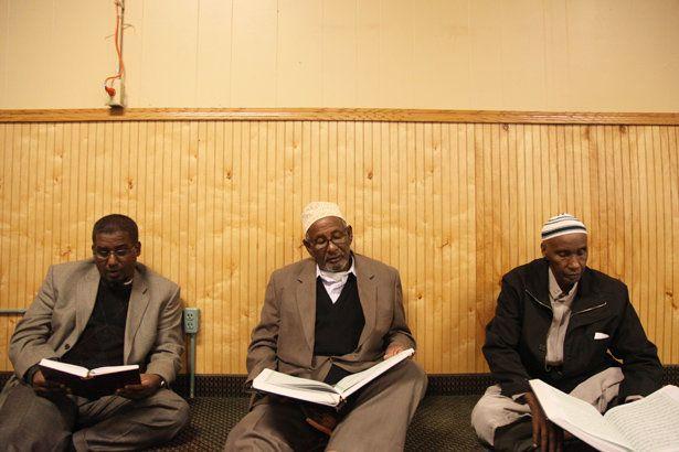 At Dar Al Hijrah, Minneapolis, elders sit around reciting Quran together.