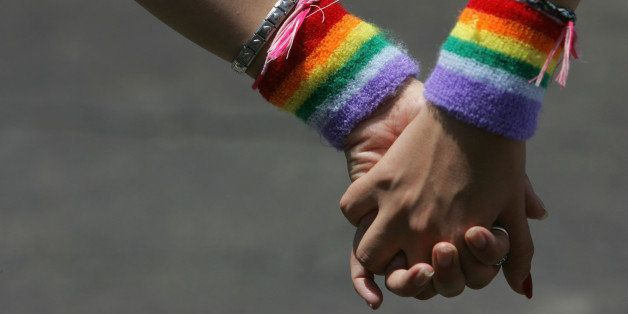 TEL AVIV, ISRAEL - JUNE 8:  A lesbian couple hold hands during the annual Gay Pride rally, on June 8, 2007 Tel Aviv, Israel's