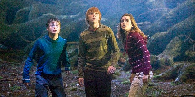 ** FILE ** In this image originally released by Warner Bros., Daniel Radcliff, portraying Harry Potter, left, Rupert Grint, p