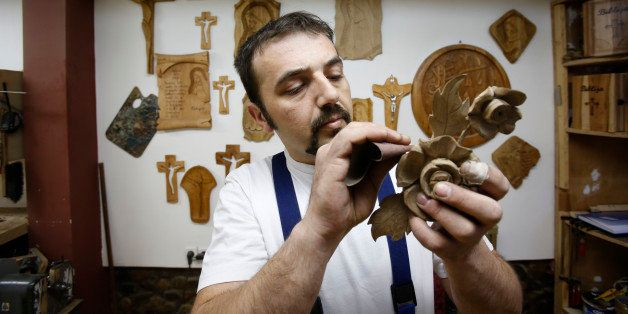 In this photo taken on Saturday, March, 28,2015 Bosnian Muslim craftsman  Edin Hajdarovac engraves decoration onto part a woo