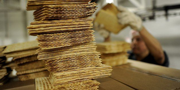 A worker at Streit's Matzo factory on the lower east side of New York stacks matzo wafers on May 9, 2012. Aron Streit, Inc.