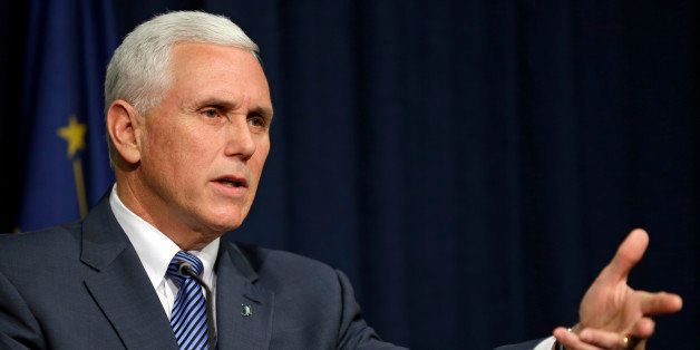 Indiana Gov. Mike Pence holds a news conference at the Statehouse in Indianapolis, Thursday, March 26, 2015. Pence has declar