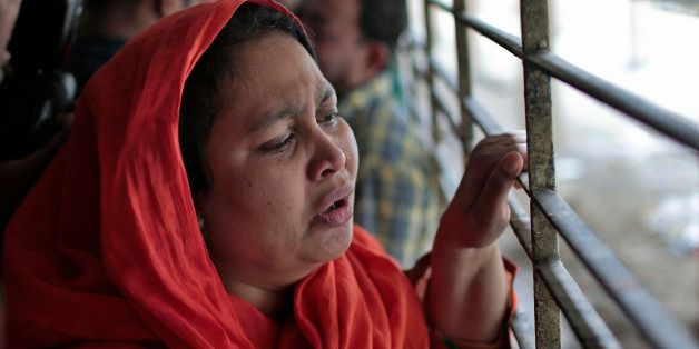 Shilpi, a cousin of late Bangladeshi blogger Washiqur Rahman Babu, wails outside a morgue at the Dhaka Medical College in Dha